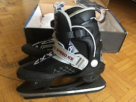 Black-and-gray ice hockey skates