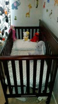 baby's brown wooden crib Silver Spring