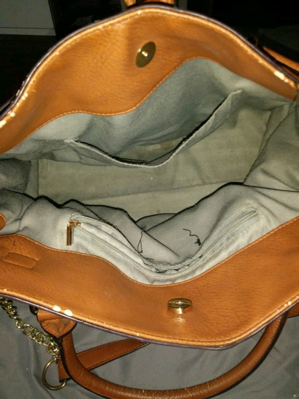 brown and black leather leather bag