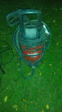black and red Husky submersible water pump
