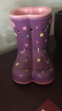 purple and pink ceramic rain boots frame container