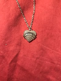 silver chain necklace with heart-shape silver pendant