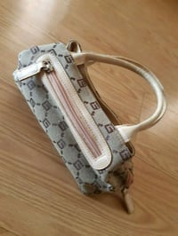 white and gray leather belt Mirabel, J7N 0L8