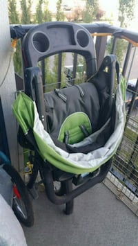 baby's black and green stroller Airdrie, T4B 2X3