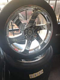 chrome 5-spoke car wheel with tire Houston, 77055
