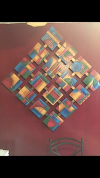red, blue and brown wooden wall decor