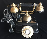 vintage black and gold rotary telephone