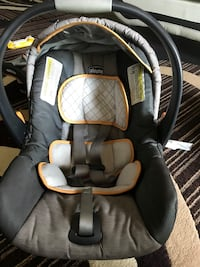 Baby's gray and black chicco car seat carrier