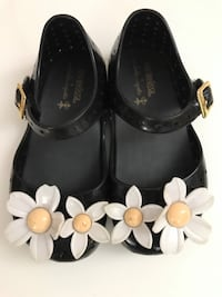 Girl's pair of black-and-white floral shoes Toronto, M9C