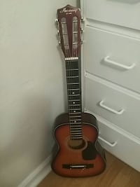brown and black acoustic guitar Sacramento, 95841