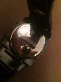 round black chronograph watch with link bracelet Winnipeg, R2J 2M1