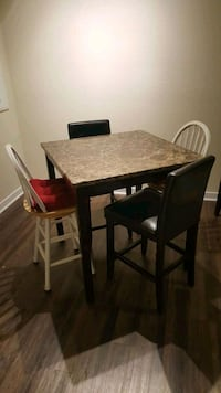 rectangular brown wooden table with four chairs dining set Orlando, 32821