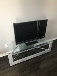 flat screen television with black wooden TV stand Richmond Hill, L4C 4M1