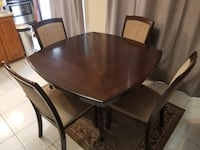 Round brown wooden table with four chairs dining set Ajax