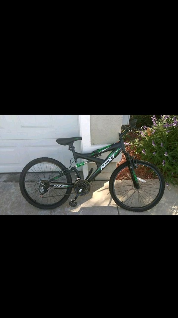 black and green full-suspension bike