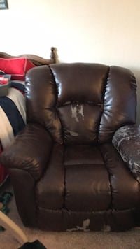 Recliner faux leather. Great chair but some leather pealing