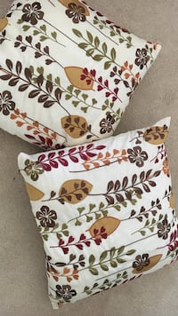 2 White and red floral throw pillows from Pier 1 Imports 26 km