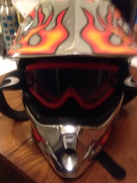 Gray, red, and black motocross helmet Madison Heights, 48071