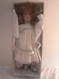 porcelain doll with box and stand