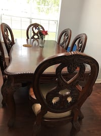 Two brown wooden framed padded chairs Sugar Land, 77498
