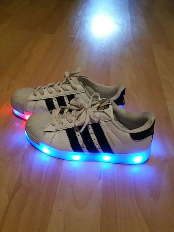 wholesale dealer e2f56 e7685 Used Lighting Adidas kids shoes. Changes color with a b for sale in Toronto  - letgo