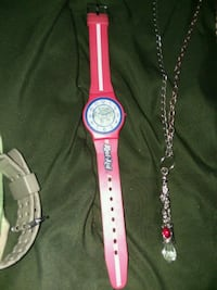 silver and red analog watch