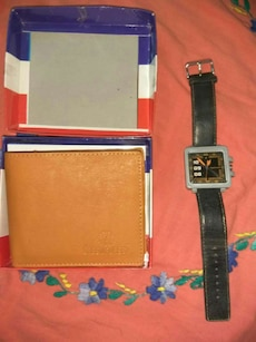 square analog watch with black leather strap