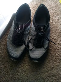 pair of gray-and-black Nike basketball shoes 169 mi