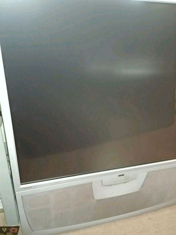 white Samsung flat screen TV 73852c71-e87b-4374-b6dc-e3f0575cea7f