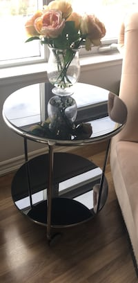 Round black glass-top table on wheels Vaughan, L6A 0J8
