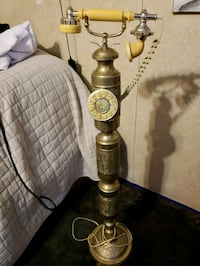 Vintage upright brass telephone with push dial. Southport, 32409
