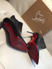 Pair of red leather platform stilettos. Christian Louboutin. Size 41. Toronto, M2J 1L2