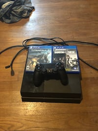 black Sony PS4 console with controller and game cases Portsmouth, 23707