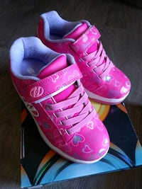 pair of pink-and-white Nike sneakers Edmonton, T6H