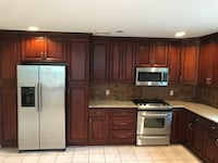 brown wooden kitchen cabinet and cabinet Hackensack, 07601