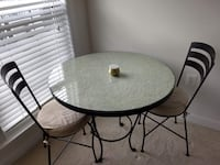 round black metal patio table HERNDON