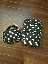 two black-and-white polka dot luggage bags New Port Richey, 34653
