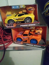 two orange and yellow Mad Machines power wings car toy boxes Saint Cloud, 34769
