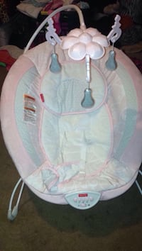 pink, white and beige Fisher-Price bouncer