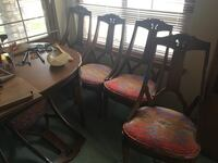 Oval brown wooden table w/3 extra leaves and six chairs! Highlands Ranch