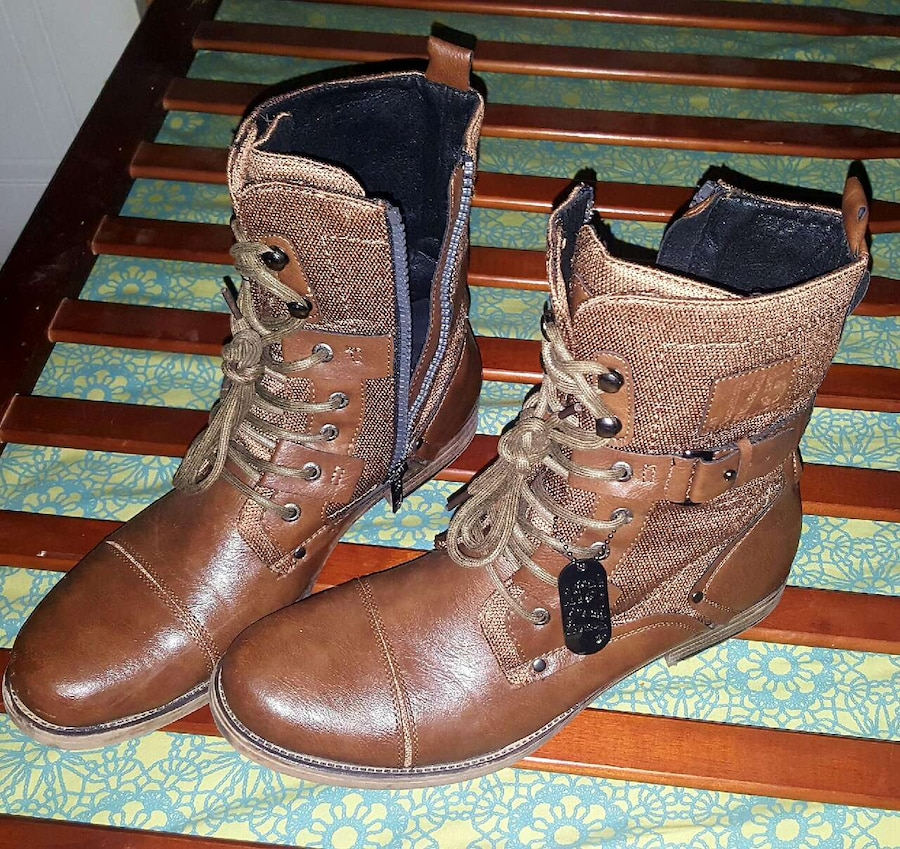 pair of brown leather military boots
