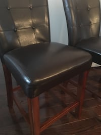two brown wooden framed black leather padded chairs Gainesville, 20155