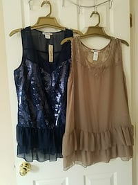 two women's black and blue sleeveless dresses
