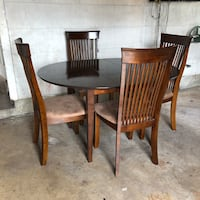 round brown wooden table with four chairs dining set 1359 mi