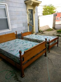 two blue-and-white bed mattresses and brown wooden bed set Lewiston, 04240
