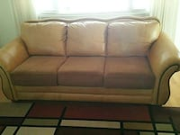 beige leather couch with fabric cushions.  Albuquerque, 87109