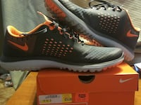 pair of black-and-orange Nike sneakers with box Liberty, 25124