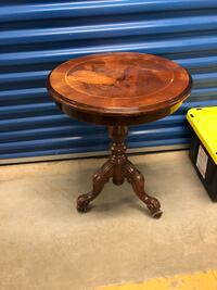 Round side accent table on roller wheels Toronto, M2R 3N1