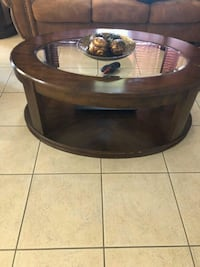 round brown wooden coffee table Kissimmee, 34744