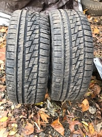 four black vehicle tires with text overlay College Park, 20740